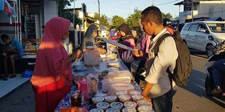 Suasana di lopo jualan pedagang di Jalan Hasanudin, Kelurahan Kota Baru, Kecamatan Alok, kota Maumere, Kabupaten Sikka, NTT, Jumat (10/5/2019).