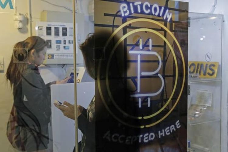 Ilustrasi Bitcon. (AP via The Guardian)
