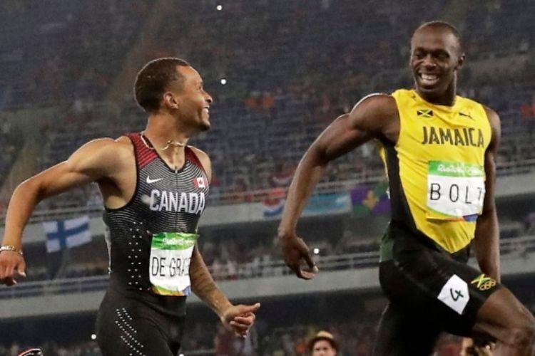 Usain Bolt (kanan) dan Andre de Grasse (kiri)