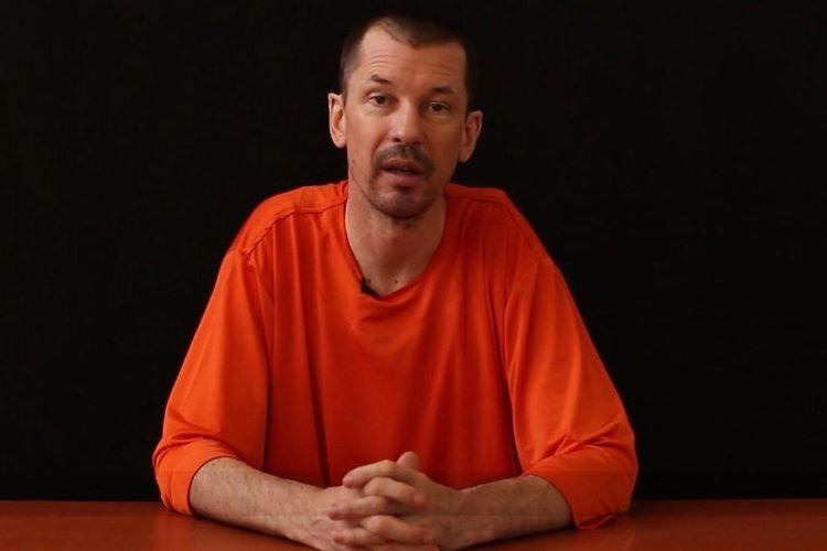 Fotografer asal Inggris, John Cantlie muncul dalam video propaganda yang dirilis ISIS pada 2014. (AFP via NBC News)