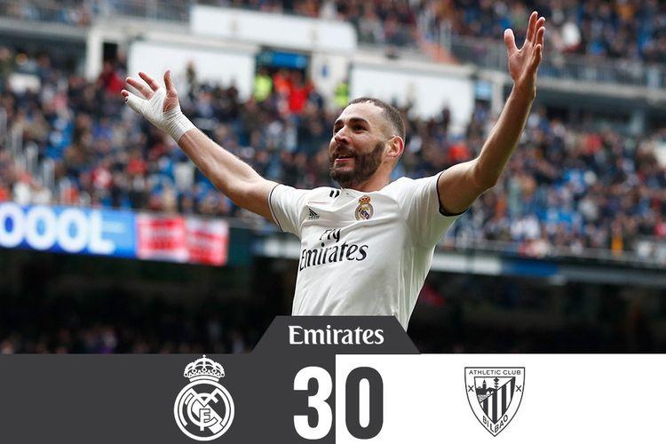 Striker Real Madrid, Karim Benzema, melakukan selebrasi setelah mencetak gol ke gawang Athletico Bilbao. Benzema mencetak hat-trick alias trigol untuk membawa Madrid menang 3-0.