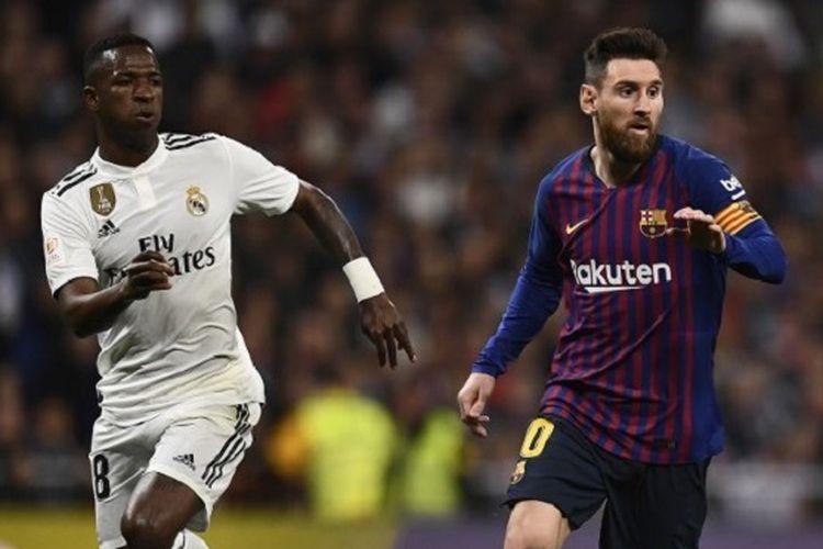Vinicius Junior membayang-bayangi Lionel Messi pada pertandingan Real Madrid vs Barcelona dalam semifinal Copa del Rey di Stadion Santiago Bernabeu, 27 Februari 2019.