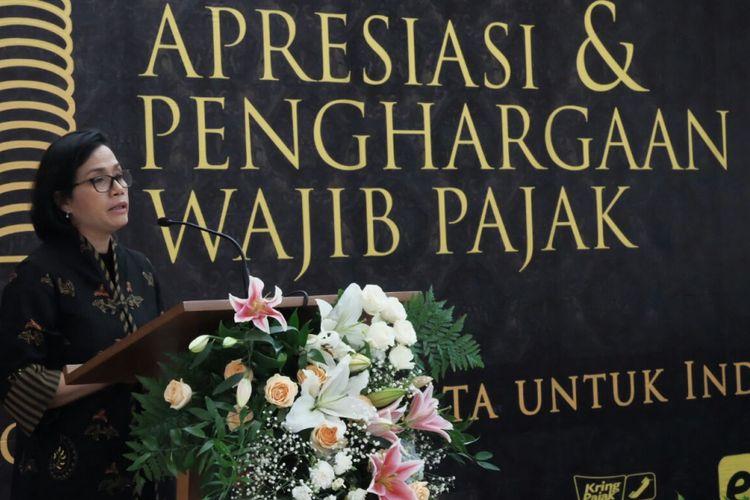 Menteri Keuangan Sri Mulyani Indrawati saat menyampaikan sambutan dalam acara penghargaan bagi wajib pajak besar di kantor Direktorat Jenderal Pajak Wajib Pajak Besar, Jalan Jenderal Sudirman, Jakarta Pusat, Selasa (13/3/2018).