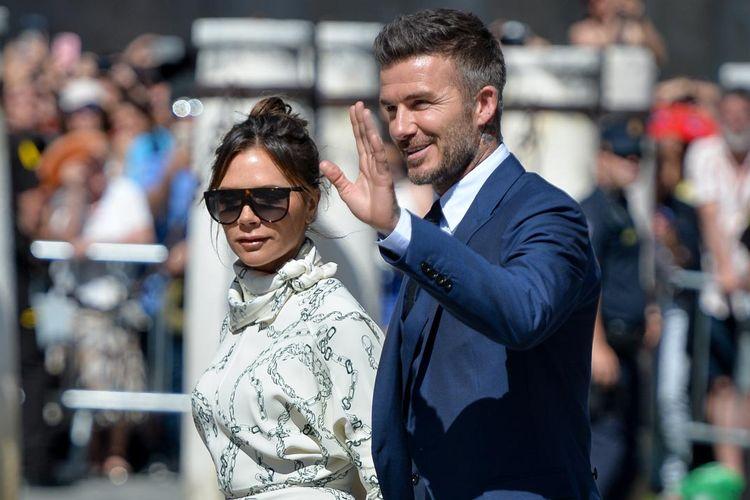 Victoria Beckham dan David Beckham saat menghadiri pernikahan pemain sepakbola Sergio Ramos dan Pilar Rubio di Sevilla, Spanyol, Sabtu (15/6/2019).