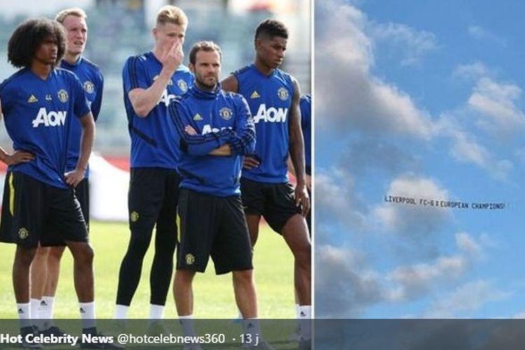 Banner fans bertuliskan Liverpool - Juara Liga Champions 6x melintas di atas Stadion tempat Man United latihan.