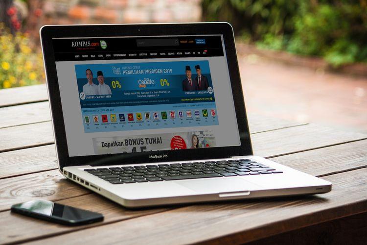 Tampilan layar laptop di Kompas.com yang menampilkan quick count atau hitung cepat Pemilu 2019.