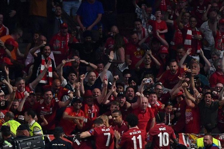 Para pemain Liverpool merayakan gol Divock Origi pada pertandingan final Liga Champions antara Liverpool vs Tottenham Hotspur di Stadion Wanda Metropolitano di Madrid pada 1 Juni 2019.