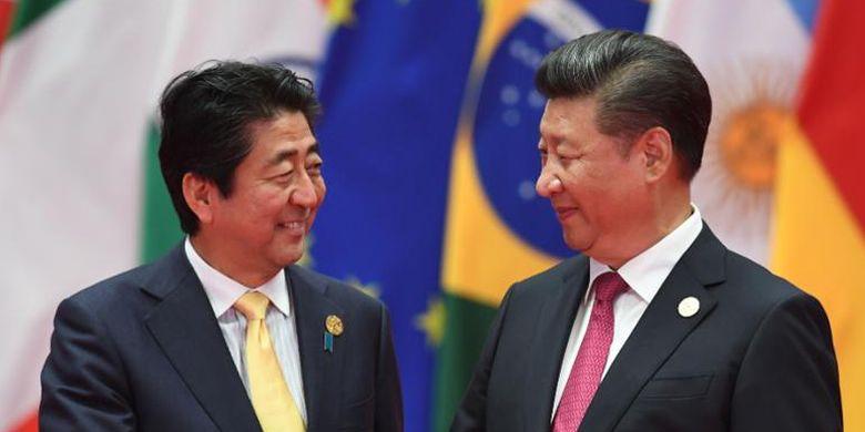 Perdana Menteri Jepang Shinzo Abe dan Presiden China Xi Jinping.