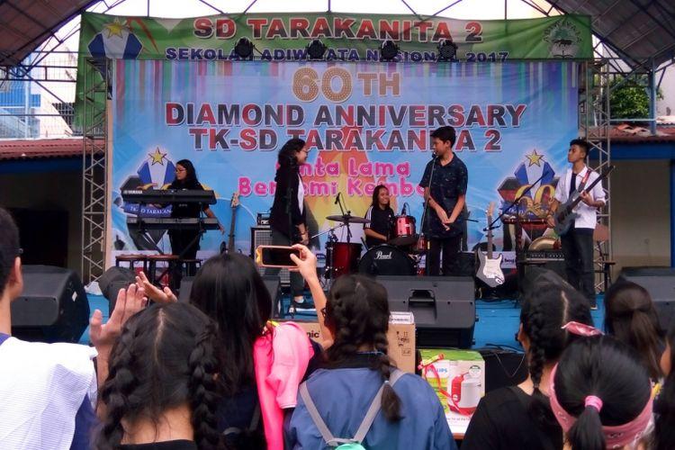 Siswa-siswi SD Tarakanita 2 ikut berpartisipasi dalam reuni HUT ke-60 TK-SD Tarakanita 2 pada Sabtu (7/4/2018)