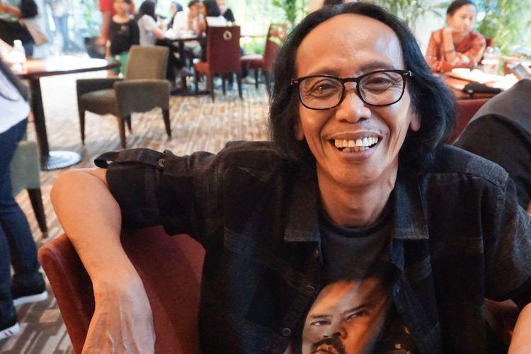 Artis peran Mandra dalam gala premiere film Si Doel The Movie di XXI Epicentrum, Kuningan, Jakarta Selatan, Minggu (29/7/2018).