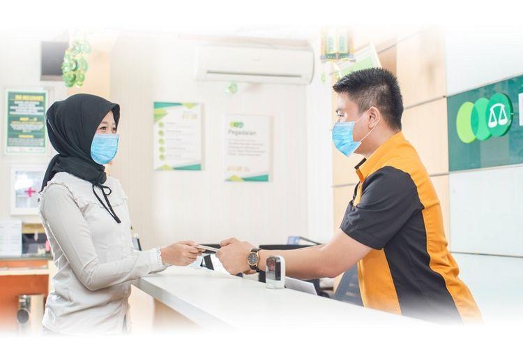 PT Pegadaian (Persero) saat melayani pembayaran tagihan gas dengan pelanggan GasKita, Kamis (7/1/2021).