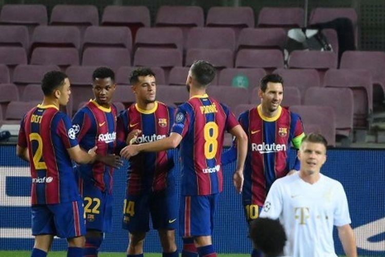 Lionel Messi, Ansu Fati, dan Philippe Coutinho merayakan gol dalam laga Barcelona vs Ferencvaros pada matchday pertama Grup G Liga Champions 2020-2021 dilangsungkan di Stadion Camp Nou, Selasa (20/10/2020) waktu setempat.