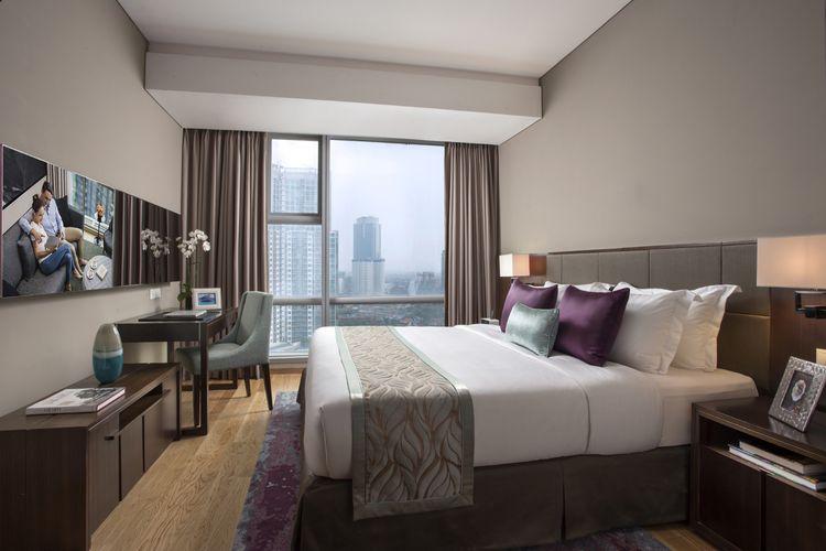 Kamar tidur utama dari kamar 2-bedroom executive di Ascott Kuningan Jakarta.