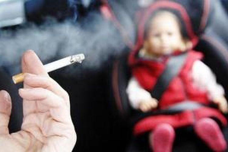 Merokok di dalam mobil sedang jadi perdebatan parlemen Inggris.
