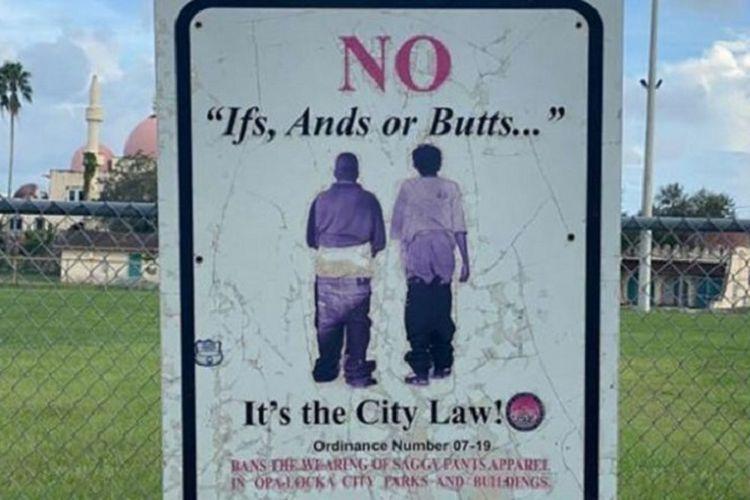 Rambu larangan memakai celana longgar atau saggy pants. Rambu dan UU terkait larangan akan segera dicabut di Opa Locka, Florida, Amerika Serikat setelah otoritas lebih banyak menargetkan orang kulit hitam dan cokelat.