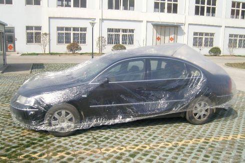 Musim Hujan, Mobil Parkir di Luar Pakai Sarung atau Tidak?