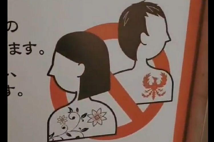 Gambar larangan memiliki tato jika ingin masuk onsen di Jepang.