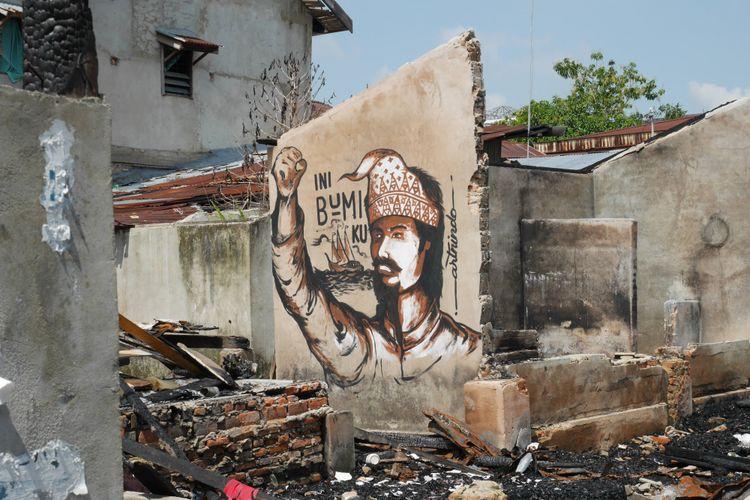 Mural di lokasi rumah yang pernah terjadi kebakaran di  Kampung Bandar, Senapelan, Pekanbaru, Riau, Jumat (9/3/2018).