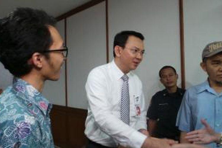 Wakil Gubernur DKI Jakarta Basuki Tjahaja Purnama mendapat ucapan selamat menjadi Gubernur DKI Jakarta, setelah Joko Widodo ditetapkan menjadi Presiden terpilih, di Balaikota Jakarta, Rabu (23/7/2014).