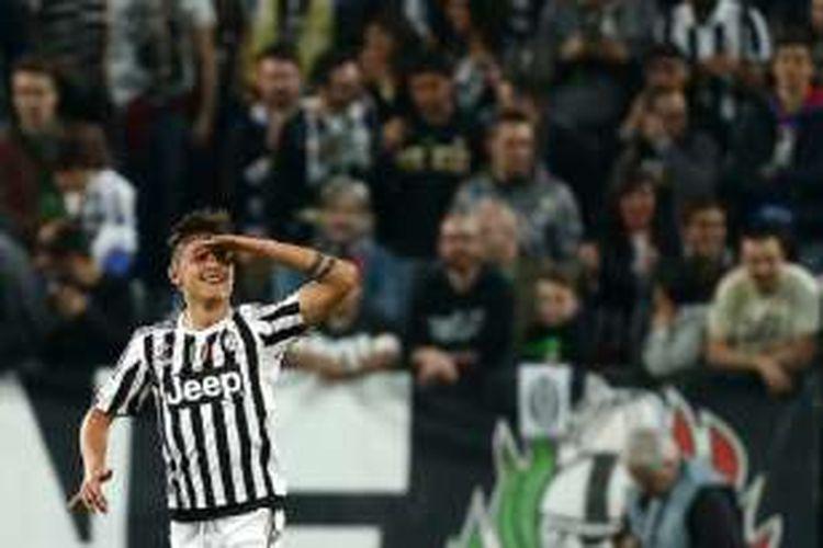 Gaya striker Juventus, Paulo Dybala, saat merayakan gol ke gawang Lazio di Stadion Juventus, Rabu (20/4/2016).