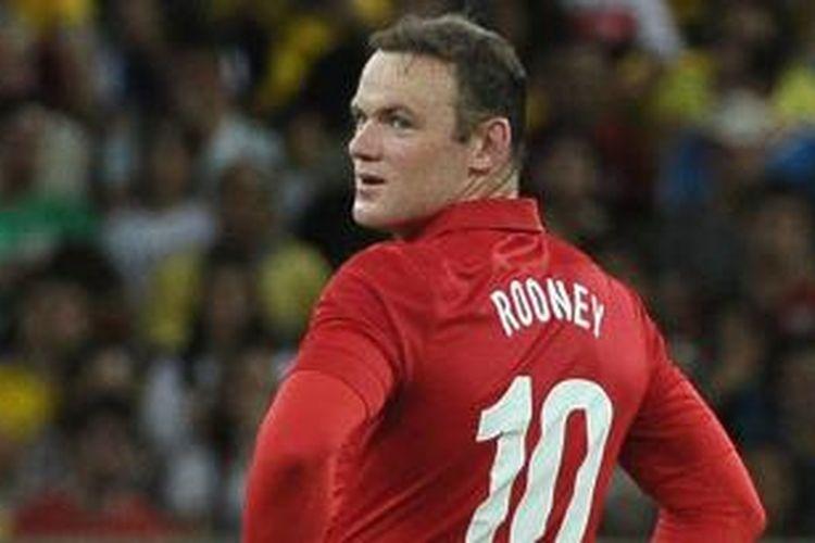 Striker Manchester United, Wayne Rooney, terus diburu Chelsea.