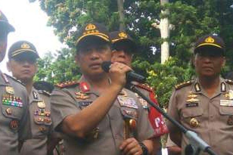 Kapolri Jenderal Tito Karnavian usai memberi penghargaan bagi 87 anggota kepolisian yang berhasil mengungkap perampokan Pulomas di Mapolda Metro Jaya, Rabu (18/1/2017).