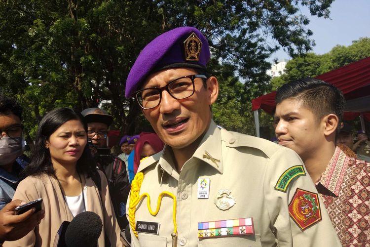 Wakil Gubernur DKI Jakarta Sandiaga Uno di hari ulang tahun ke-56 Resimen Mahasiswa Jakayakarta di Lapangan IRTI Monas, Sabtu (12/5/2018).