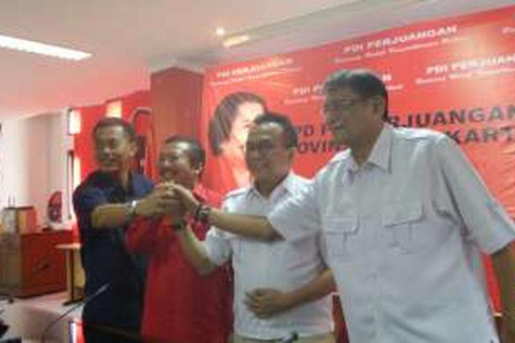 Plt. Ketua DPD PDI-P DKI Jakarta Bambang Dwi Hartono bersama Ketua DPD Partai Gerindra DKI Jakarta Mohamad Taufik.