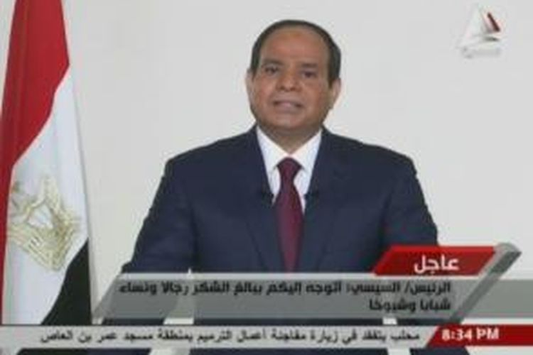 Mantan Panglima Angkatan Bersenjata Mesir, Jenderal Abdel Fattah al-Sisi, berpidato di televisi setelah dirinya dinyatanyan resmi memenangkan pemilihan presiden.