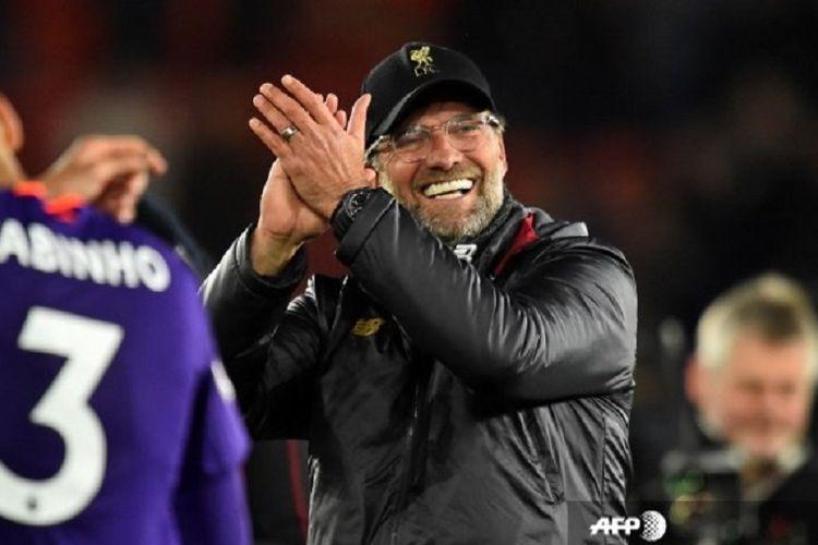 Juergen Klopp merayakan kemenangan 2-0 di laga Liverpool vs Porto pada leg pertama perempat final Liga Champions, 10 April 2019.