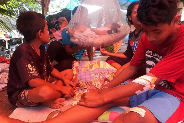 Masyarakat di Desa Balitata, Kecamatan Gane Barat, Kabupaten Halmahera Selatan, Maluku Utara masih bertahan di lokasi pengungsian, Minggu (21/07/2019)