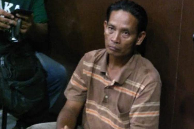 Rahmat (50) ojek online yang membuat laporan palsu ketika berada di Polresta Palembang, Kamis (8/11/2018). Rahmat sebelumnya membuat laporan di Polisi telah menjadi korban begal.