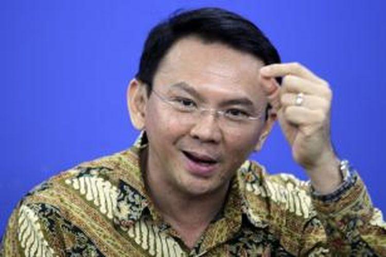 Wakil Gubernur DKI Jakarta Basuki Tjahaja Purnama memberikan penjelasan saat berkunjung ke kantor Redaksi Kompas.com di Palmerah, Jakarta Selatan, Rabu (15/1/2014).