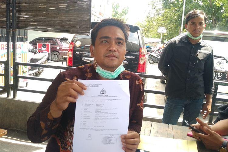 Oloan Butarbutar selaku kuasa hukum korban pencabulan melaporkan sopir taksi online ke Polrestabes Medan.