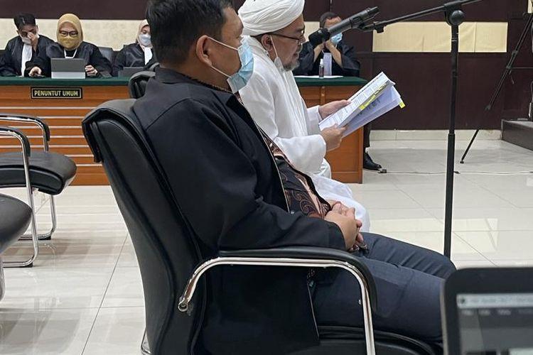 Rizieq Shihab ketika membacakan pleidoi atau nota pembelaan terkait kasus tes usap RS Ummi Bogor yang menjeratnya, Kamis (10/6/2021).