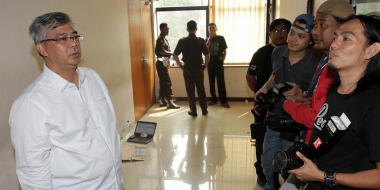 Mantan Ketua Mahkamah Konstitusi (MK) Akil Mochtar, hadir di Pengadilan Tipikor Jakarta untuk persidangan terdakwa Bupati nonaktif Morotai, Maluku Utara, Rusli Sibua, Senin (21/9/2015).
