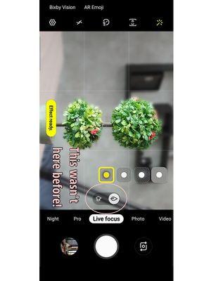 Ilustrasi toggle penggantian lensa di aplikasi kamera Galaxy S10 saat menggunakan mode Live Focus.