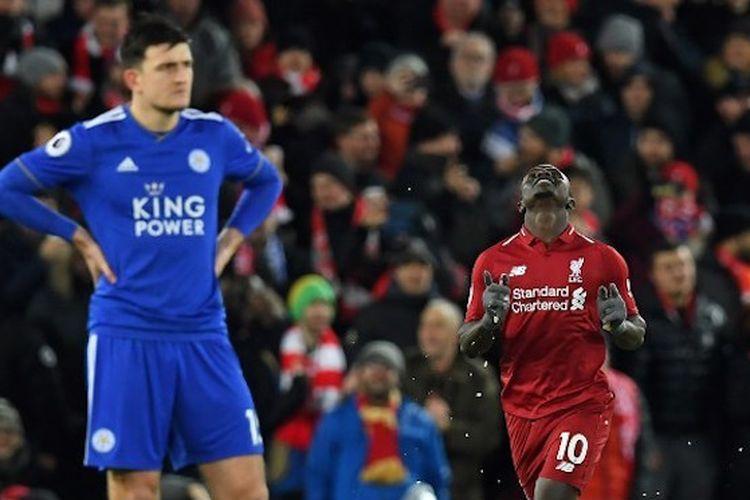 Perbedaan ekspresi antara Harry Maguire dan Sadio Mane yang beres mencetak gol pada pertandingan Liverpool vs Leicester City dalam lanjutan Liga Inggris di Stadion Anfield, 30 Januari 2019.