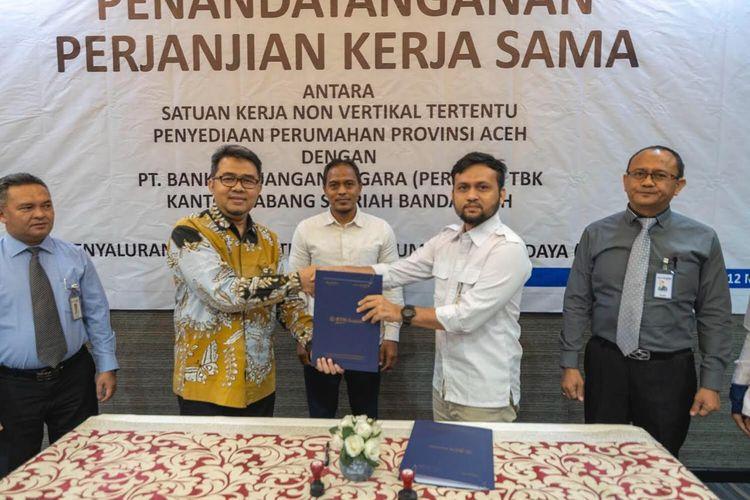 Penandatanganan perjanjian kerjasama Satuan Kerja Non Vertikal Tertentu (SNVT) Penyediaan Perumahan Provinsi Aceh dengan Bank Tabungan Negara (BTN).
