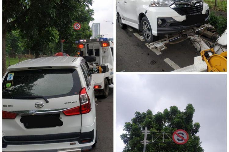 Mobil yang diderek pihak Sudinhub Jakbar karena parkir di jalur sepeda sekitar kawasan Kembangan, Jakarta Barat