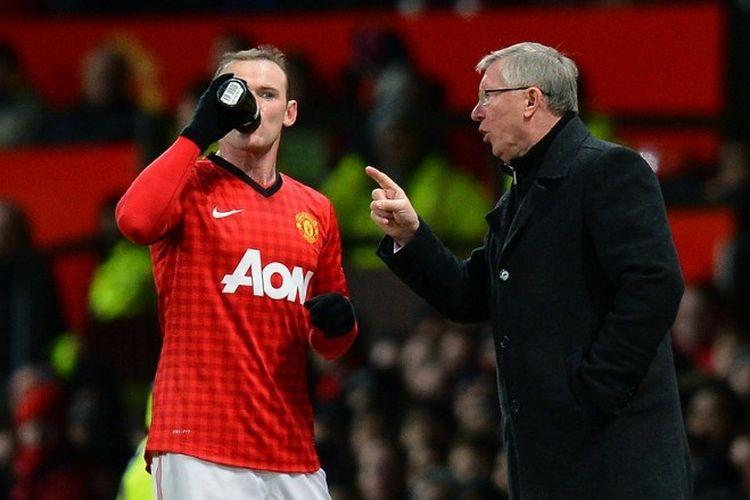 Wayne Rooney dan Sir Alex Ferguson kala keduanya masih membela Manchester United.