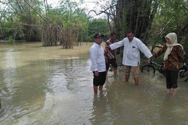 Banjir yang kini mulai menggenang di Kecamatan Cerme, Gresik, Kamis (2/1/2020). Salah satunya di Desa Ngembung.