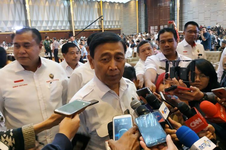 Menteri Koordinator Bidang Politik, Hukum, dan Keamanan (Menko Polhukam) Wiranto saat menghadiri Rapat Koordinasi Nasional (Rakornas) penyelenggaraan Pemilu 2019 di Hotel Grand Paragon, Jakarta, Rabu (27/3/2019).