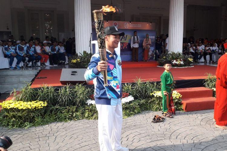 Ketua INAPGOC Raja Sapta Oktohari dalam acara kirab obor Asian Para Games 2018 di Balaikota DKI Jakarta, Minggu (30/9/2018).