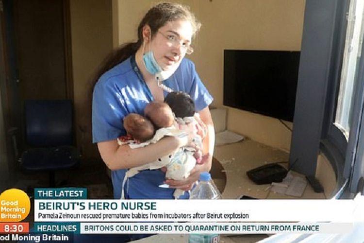 Perawat bernama Pamela Zeinoun bersama tiga bayi yang diselamatkannya dari ledakan di Beirut, Lebanon, pada 4 Agustus 2020.