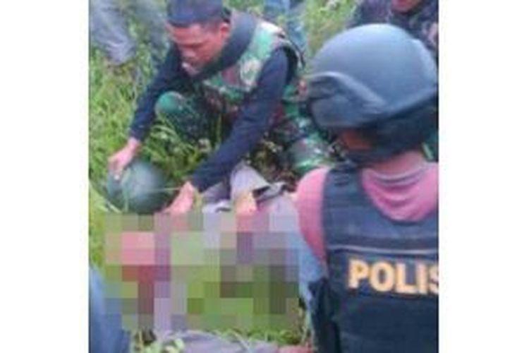 Baku tembak di Lanny Jaya, Papua, Senin (28/7/2014), menewaskan dua polisi.