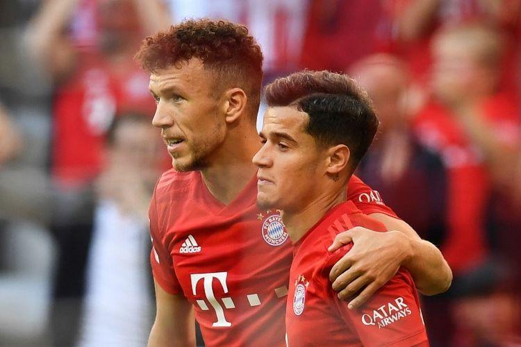 Ivan Perisic merayakan gol Philippe Coutinho pada pertandingan Bayern Muenchen vs Koeln di Allianz Arena dalam lanjutan Bundesliga, 21 September 2019.