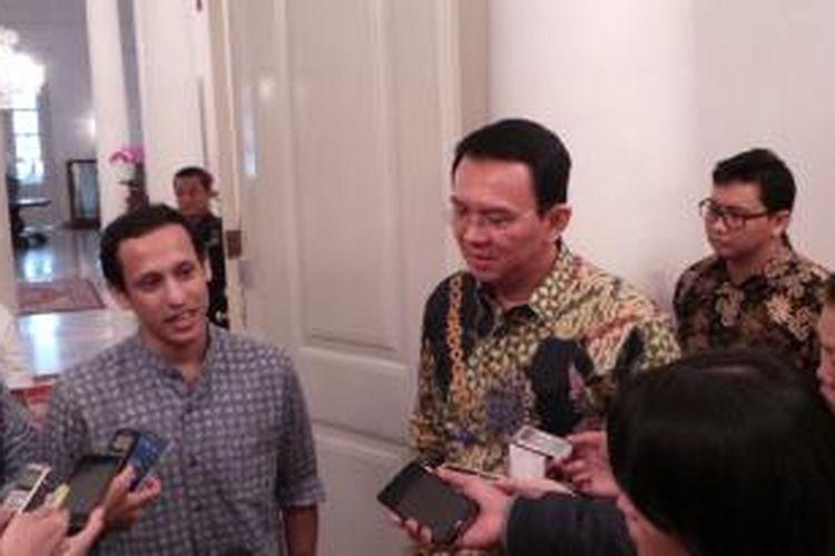 Gubernur DKI Jakarta Basuki Tjahaja Purnama (kanan) bersama CEO PT Go-Jek Indonesia Nadiem Makarim, di Balai Kota, Selasa (17/2/2015).