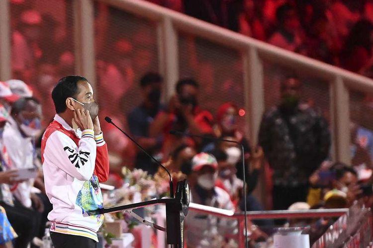 Presiden Joko Widodo bersiap memberikan sambutan sekaligus membuka secara resmi PON Papua di Stadion Lukas Enembe, Kompleks Olahraga Kampung Harapan, Distrik Sentani Timur, Kabupaten Jayapura, Papua, Sabtu (2/10/2021). Resmi dibuka oleh Presiden Jokowi, PON XX Papua 2021 akan berlangsung pada 2-15 Oktober 2021.