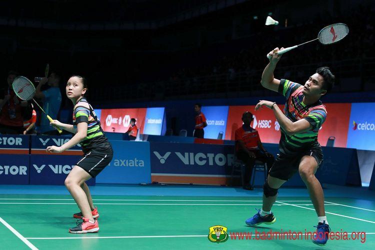 Tontowi Ahmad/Winny Oktavina Kandow berlaga dalam Malaysia Open 2019 di Axiata Arena, 4 April 2019.